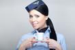 Attractive flight attendant servicing coffee