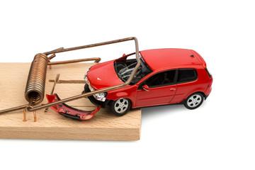 Modellauto in einer Mausefalle