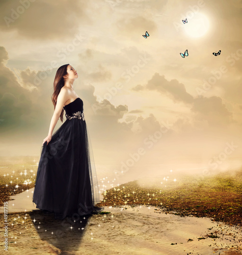 Beautiful girl at a brook under the moon light