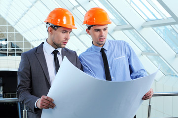 Two men in hard hats at construction site