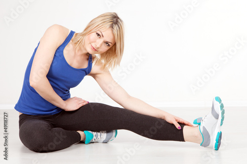 Slim woman exercising in a gym
