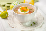 White borscht with eggs and white sausage.Polish easter soup