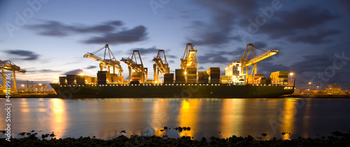 Cargo ship in port at dusk