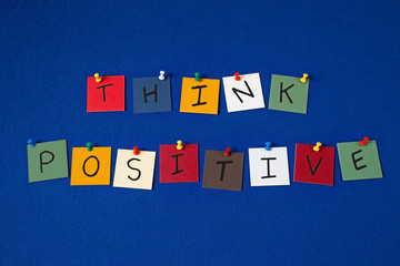'THINK POSITIVE' - sign on noticeboard for business, seminars.
