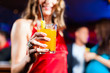 Woman with cocktail in bar or club