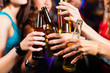 People drinking beer in bar or club - 49122319