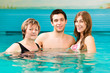 Wellness - woman and couple in swimming pool
