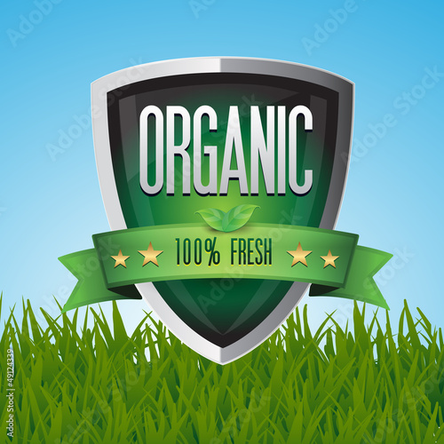 Green 100% organic shield on grass