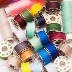 colorful sewing thread on white background