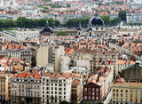 View on tenement houses roofs and Hotel Dieu hospital in Lyon poster