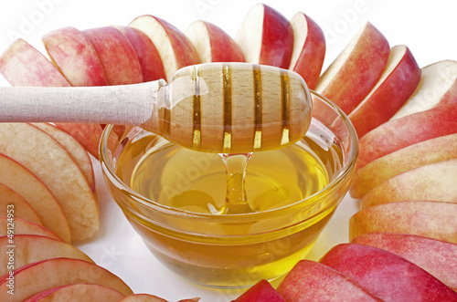 Cut into slices of apples with a bowl of honey