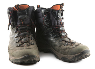 well worn and muddy hiking boots