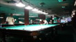 Playing russian billiard in a poolroom