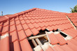 Damaged red tile roof construction house - 49126124