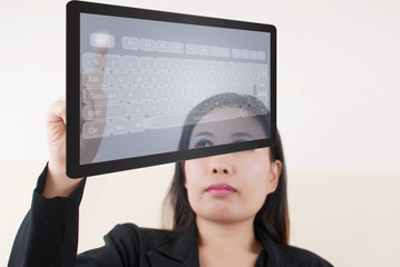 business lady pushing transparent keyboard