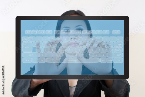 business lady pushing transparent keyboard