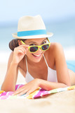 Woman on beach with sunglasses - Fine Art prints