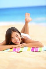 Vacation beach woman lying down relaxing looking