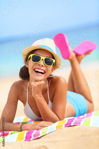 Beach woman laughing fun in summer