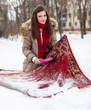 woman cleans rug with snow