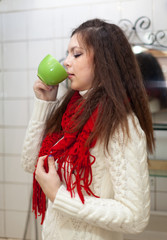 Colds woman with cup of  medicine gargling