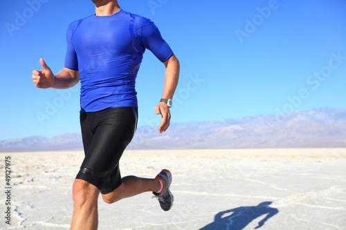 Sport - runner running in desert