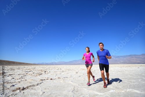 Athletes running sport fitness couple outdoor
