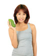 Isolated young asian woman with a mango over white.