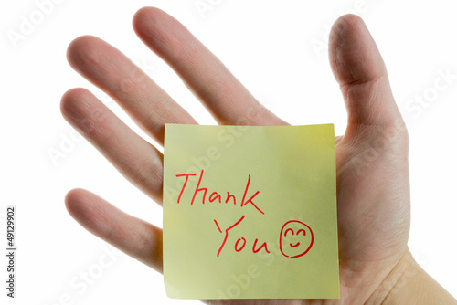 hand showing a post-it to thank you