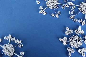 beautiful paper snowflakes, on blue background