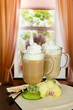 Fragrant coffee latte in glasses cups with vanilla pods,