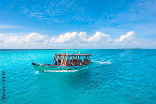 Wooden Maldivian traditional dhoni boat on a sunny day