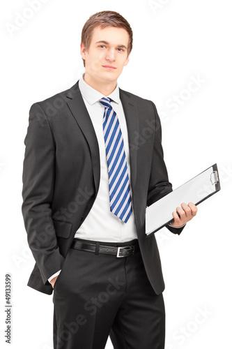 Busniessman posing with clipboard