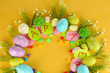 Circular composition for Easter on yellow background