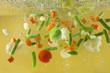 Vegetables splash in water soup cooking concept