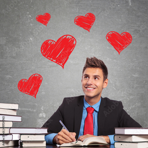 business man writting a love letter