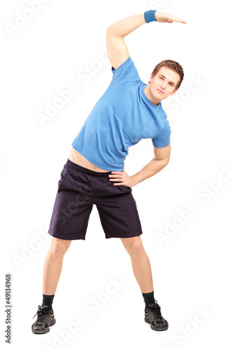 Full length portrait of a young man exercising