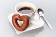 Gingerbread heart with coffee as a love symbol
