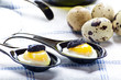 Quail eggs with caviar in black spoons
