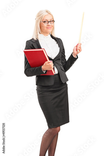 Young teacher holding a folder and posing