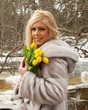 Portrait of beautiful blond woman  with flowers in winter