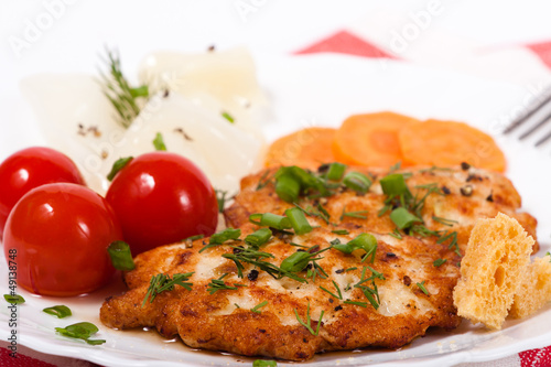 Fried chicken chopped meat cutlet with salty vegetables