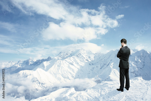 man looking to mountains