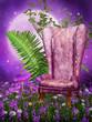 Stary fotel na łące z kwiatami i paprocią