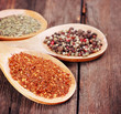 Various spices in wooden spoons close-up