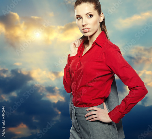 Cumulus clouds on sunset sky background