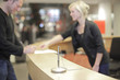 Blond woman working at help desk
