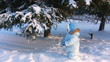 Child shakes off snow trees