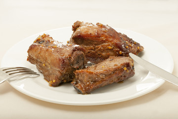 spareribs cooked in mustard and honey sauce
