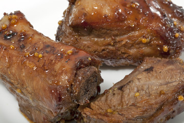 spareribs cooked in mustard and honey sauce closeup